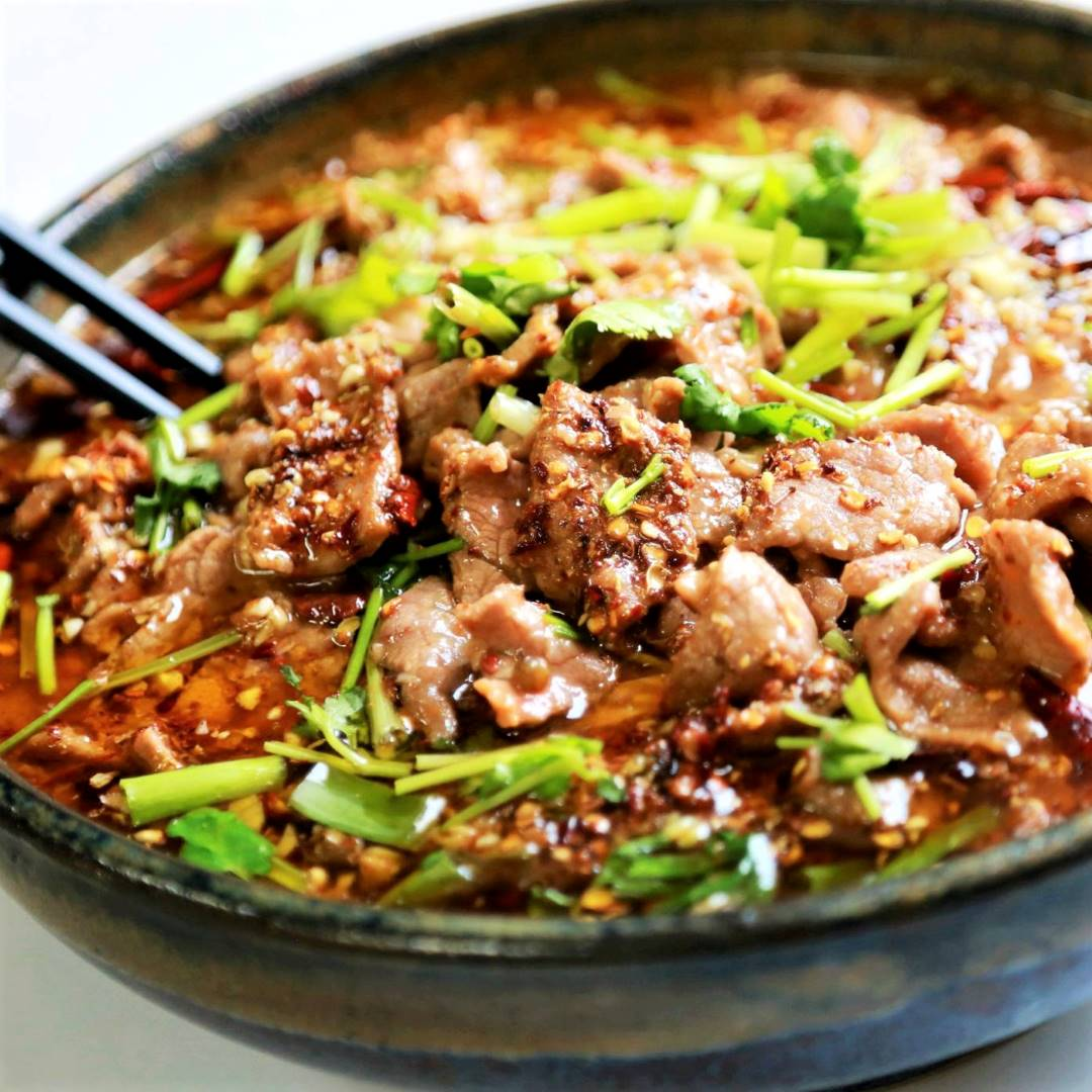 Poached sliced beef and vegetables in hot chili oil 11