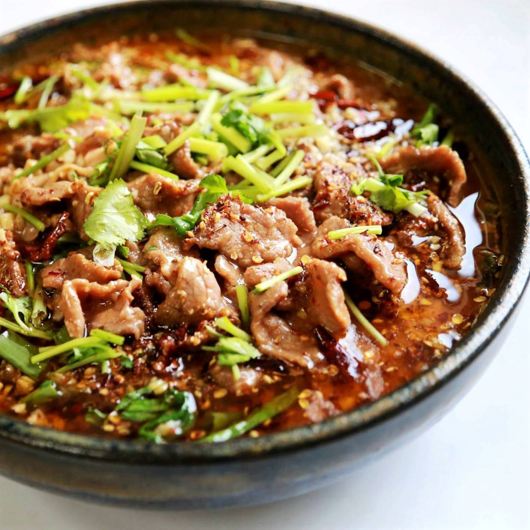 Spicy poached beef with bean sprouts and bean curd skin