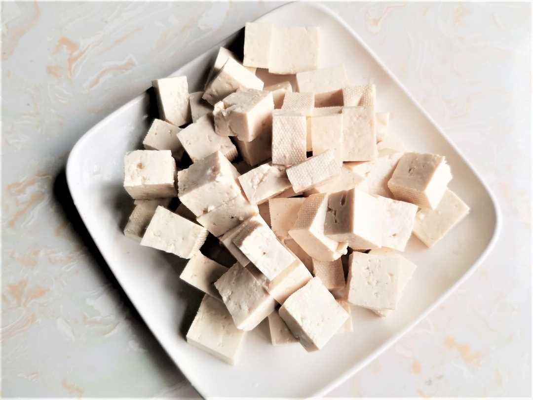 Cut tofu into cubes of even size