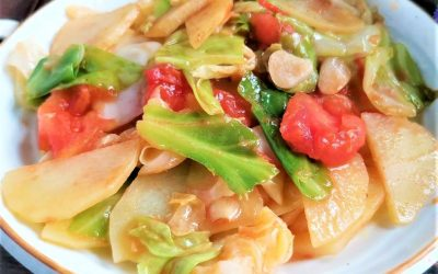 light vegetarian food tomatoes and potatoes Stir-Fry with cabbage