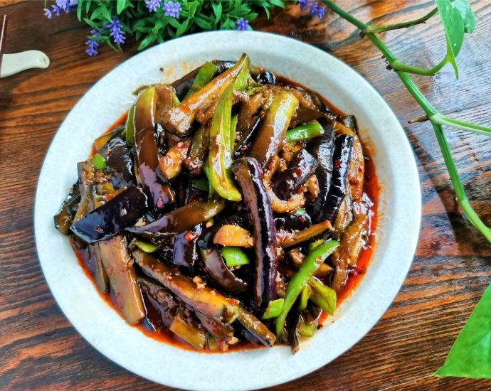 Chinese Eggplants with cubanelle peppers in chili garlic sauce