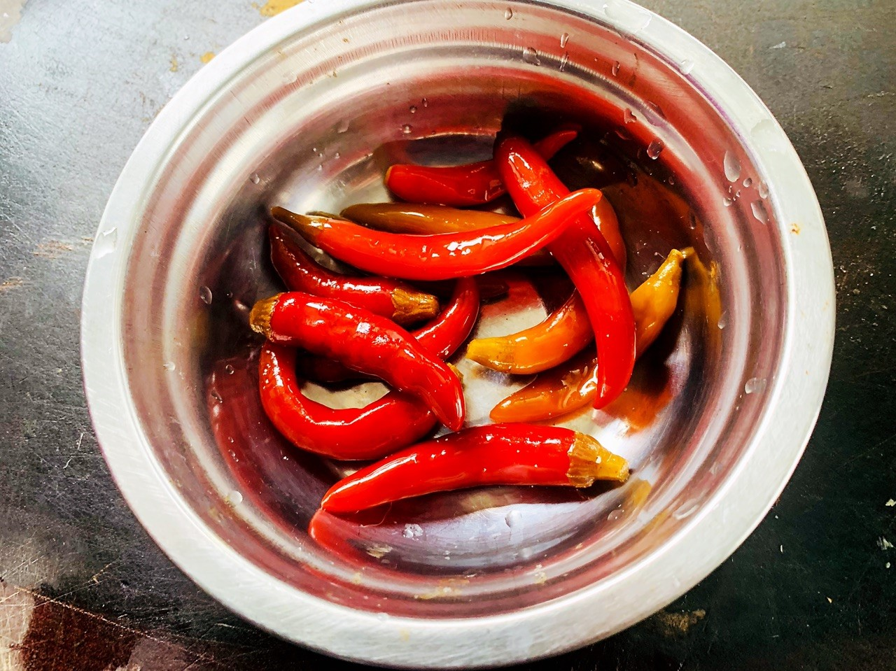 cut the pickled sour pepper into segments